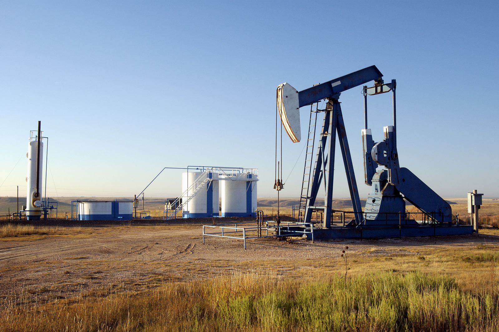 bigstock-Oil-Well-And-Storage-Tanks-307094.jpg